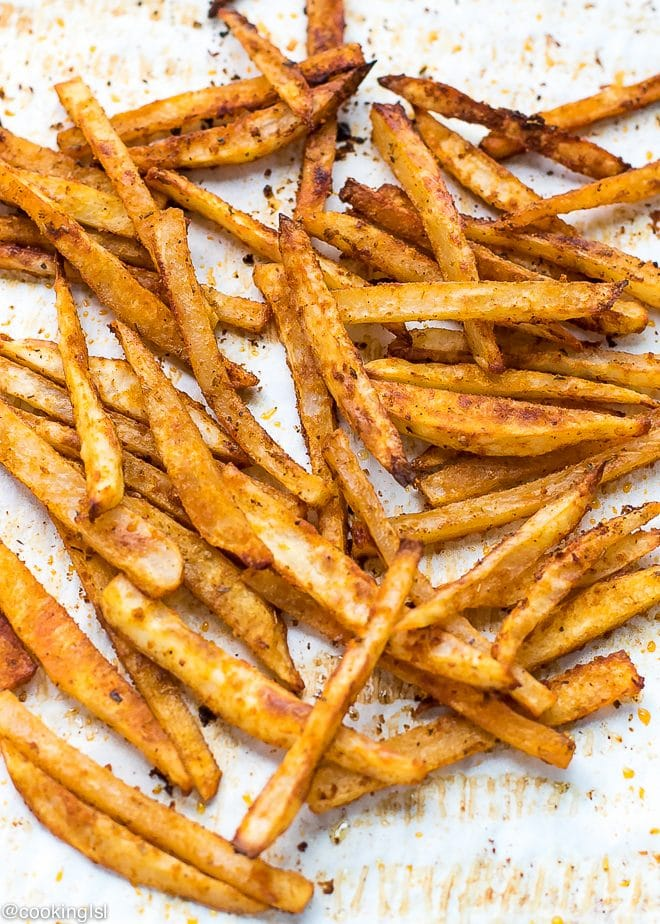 Crispy oven fries on parchment paper